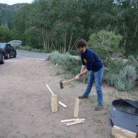 Alex chopping wood for the fire
